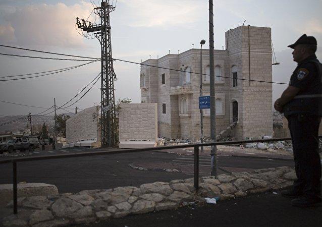 Muro de hormigón en el barrio palestino de Jabel Mukaber