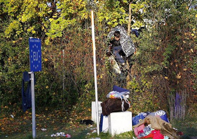 Migrante en la frontera entre Austria y Slovenia