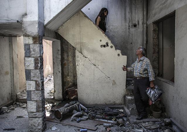 Cristianos sirios en su casa en Homs