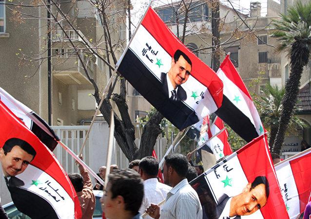 Partidarios de Bashar Asad, presidente de Siria