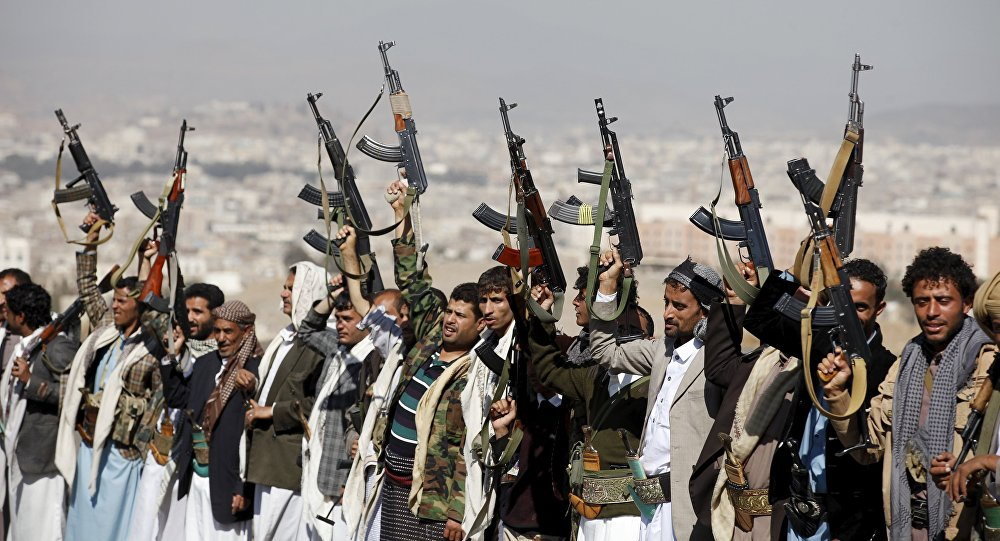 Tribesmen loyal to the Houthi movement shout slogans and raise their weapons during a gathering to show their support for the group, in Yemen's capital Sanaa December 14, 2015