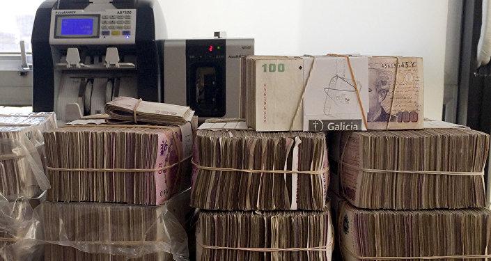 Pesos argentinos en una casa de cambios en Buenos Aires