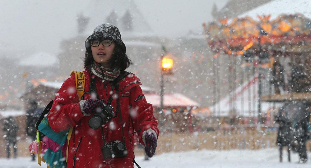 Una turista china