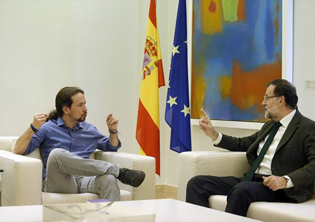 Líder de Podemos, Pablo Iglesias, y presidente del Gobierno español, Mariano Rajoy (archivo)