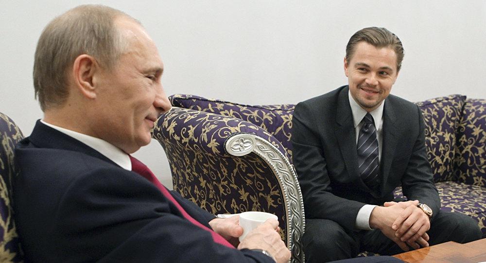El presidente de Rusia Vladímir Putin y el actor Leonardo DiCaprio (archivo)