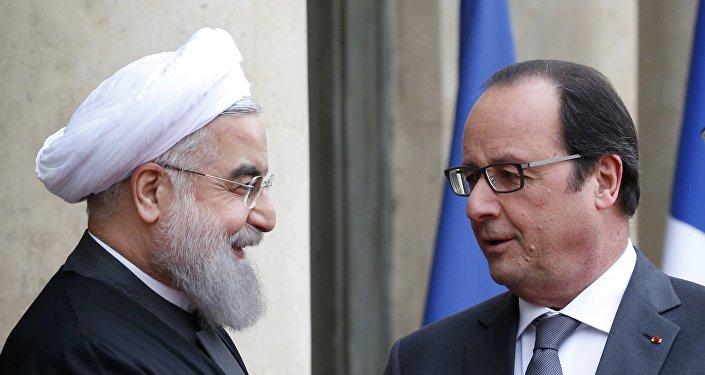 El presidente de Irán, Hasán Rohani, y el presidente de Francia, François Hollande
