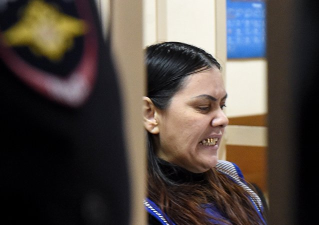 Gyulchekhra Bobokulova, a nanny suspected of killing a young girl in her care, reacts inside a defendants' cage during a hearing at a court in Moscow, on March 2, 2016.