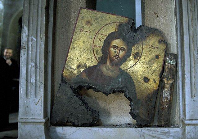 La imagen de Cristo quemada en una iglesia en Siria