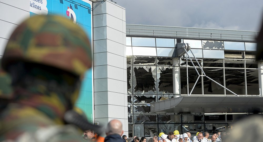 Windows of the terminal at Brussels national airport are seen broken during a ceremony following bomb attacks in Brussels metro and Belgium's National airport of Zaventem