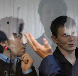 Ciudadanos rusos, Evgueni Eroféev y Alexandr Alexándrov, durante el proceso penal
