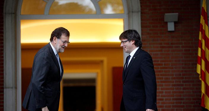 Mariano Rajoy, presidente del Gobierno español, y Carles Puigdemont, presidente de Cataluña