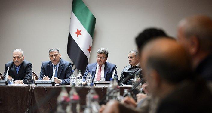 Miembros del ACN durante las consultas intersirias (archivo)