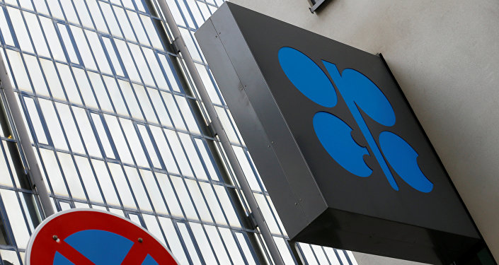 The OPEC logo is pictured behind a traffic sign at its headquarters in Vienna