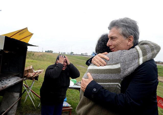 Visita de Mauricio Macri, presidente de Argentina, a la parrilla de Alfredo Farías