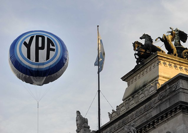 An inflatable baloon with the Argentine national oil company YPF logo floats in the air in front the Congress bulding before the voting of the bill nationalizing the company, on May 3, 2012