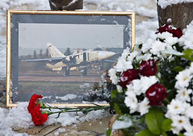 Flores en memoria del piloto del SU-24 derribado en Siria