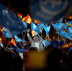Mariano Rajoy, actual presidente en funciones y líder del Partido Popular,  y los partidarios del PP