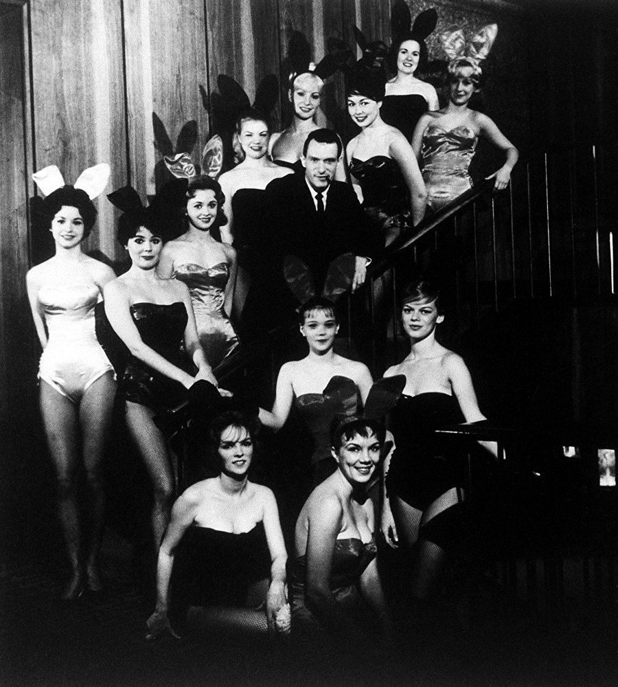 Hugh Hefner, founder and chairman of the Playboy Enterprises, Inc., is pictured amid a group of Bunnies, at the flagship Playboy Club, in Chicago, Ill., circa 1960