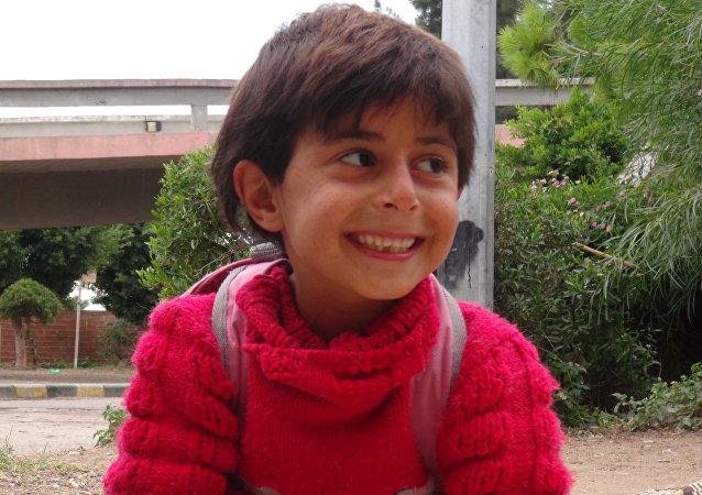 Un niño del liberado barrio Bani Zaid