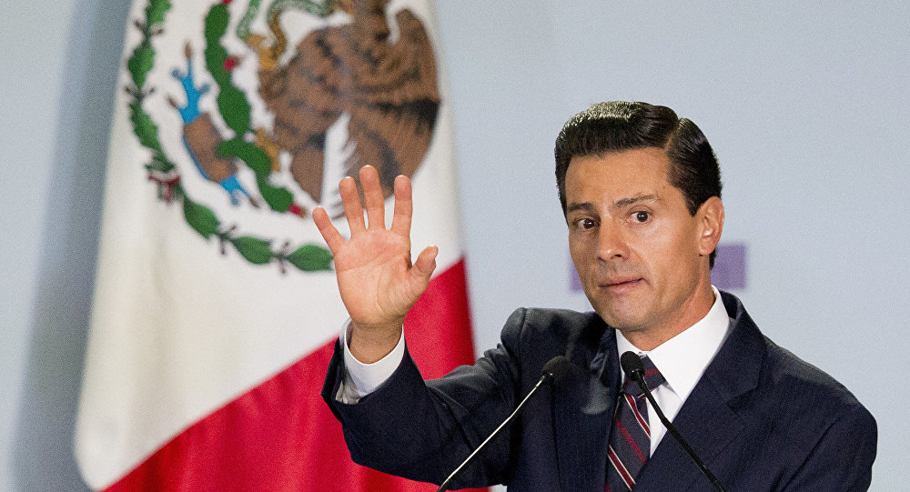 Mexican President Enrique Pena Nieto declares open the 8th National Forum for Security and Justice, after delivering his address in Mexico City, Tuesday, June 7, 2016.