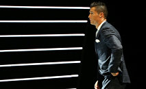 Real Madrid's Cristiano Ronaldo of Portugal arrives on the stage to receive The Best Player UEFA 2015/16 Award during the draw ceremony for the 2016/2017 Champions League Cup soccer competition at Monaco's Grimaldi in Monaco