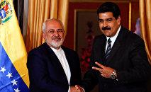 Mohamad Javad Zarif, canciller de Irán, y Nicolás Maduro, presidente de Venezuela