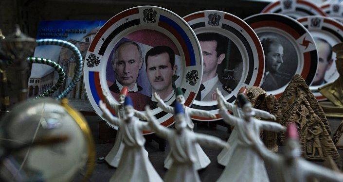 Retratos de Vladímir Putin y Bashar Asad (archivo)