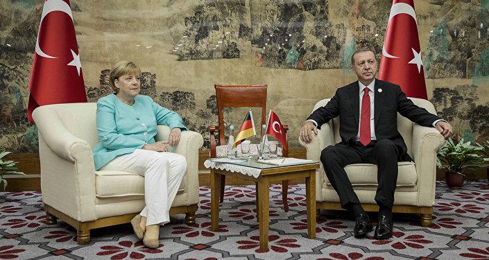 Angela Merkel, canciller alemana, y Recep Tayyip Erdogan, presidente de Turquía durante la reunión en el marco de la cumbre del G20