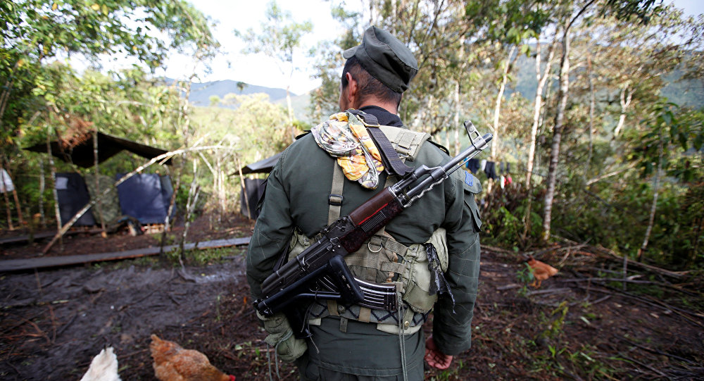A member of the 51st Front of the Revolutionary Armed Forces of Colombia (FARC) walks at a camp in Cordillera Oriental, Colombia, August 16, 2016