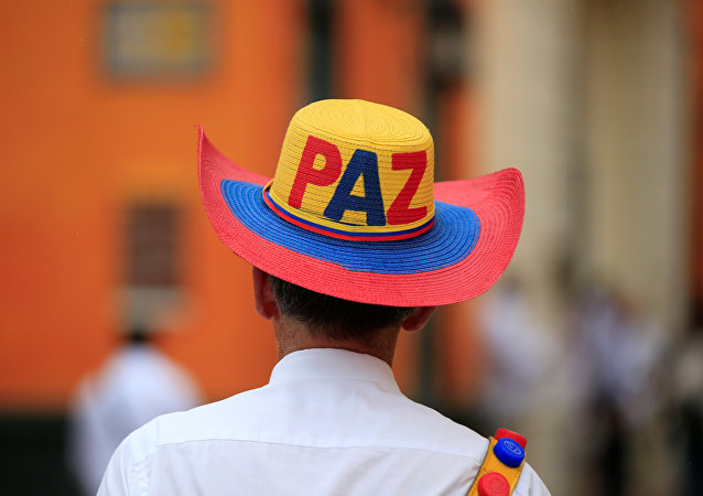 A man walks on a street wearing a hat with the writing Peace in Cartagena, Colombia, September 26, 2016.