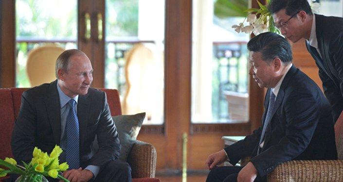 Vladimir Putin, el presidente de Rusia, y Xi Jinping, el presidente de China