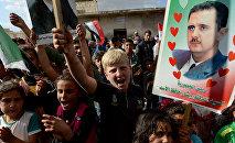 Partidarios de Bashar Asad en la ciudad de Hama