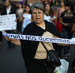 A woman takes part in a march to protest violence against women and the murder of a 16-year-old girl in a coastal town of Argentina last week, at Reforma avenue, in Mexico City, Mexico, October 19, 2016