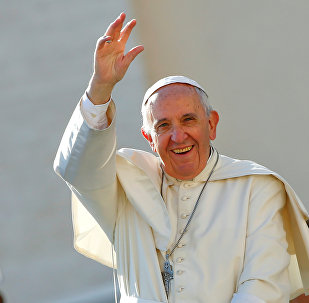 Pope Francis waves as he arrives to lead a special Jubilee audience in Saint Peter's square at the Vatican