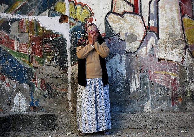 Una mujer llora tras el atentado en Diyarbakir
