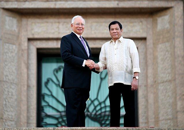 Najib Razak, primer ministro de Malasia y Rodrigo Duterte, presidente de Filipinas,