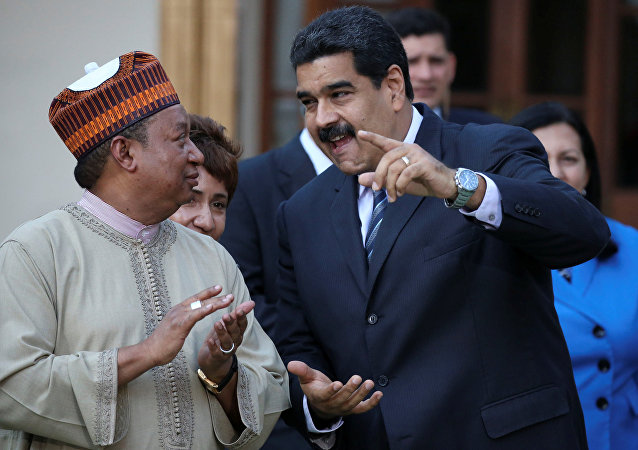 rganization of the Petroleum Exporting Countries (OPEC) Secretary-General Mohammed Barkindo (L) and Venezuela's President Nicolas Madur
