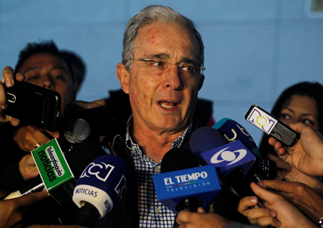 Colombian former president and Senator Alvaro Uribe talks to the media after a meeting with Colombia's President Santos at military air base in Rionegro, Colombia