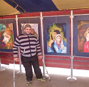 Artista paralítico sirio, Shadi Suleiman