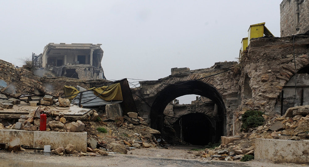 A general view shows damage on the entrance to al-Zarab souk in the Old city of Aleppo, Syria December