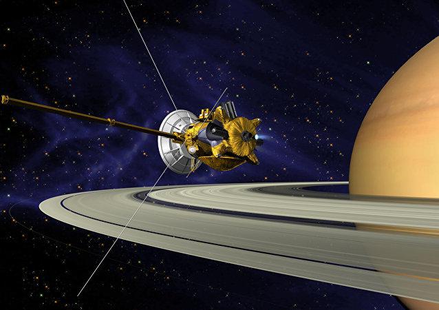 Concepción artística de la sonda Cassini en su maniobra de inserción en la órbita de Saturno