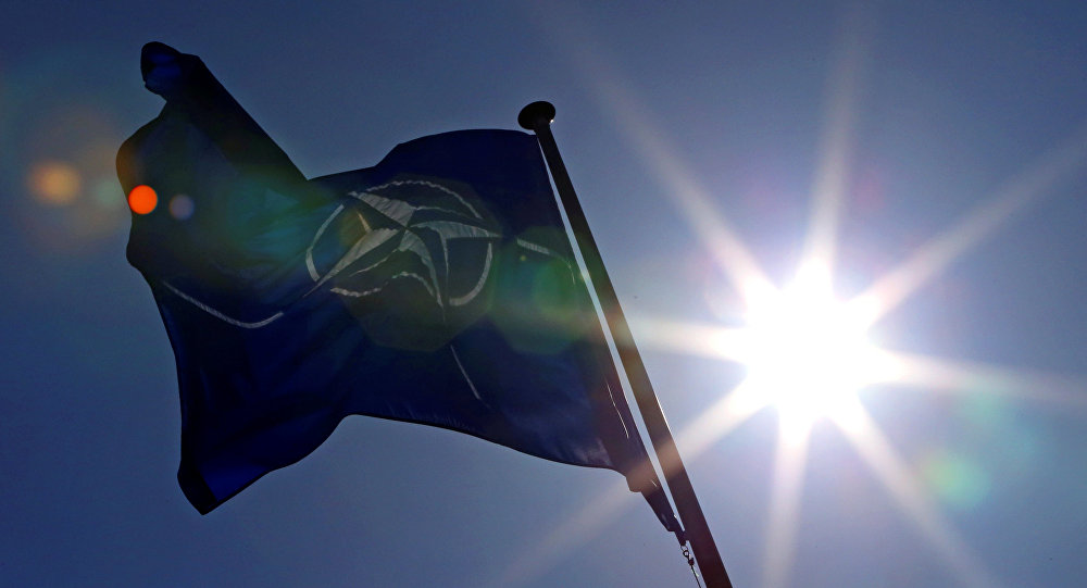 A NATO flag flies at the Alliance's headquarters in Brussels