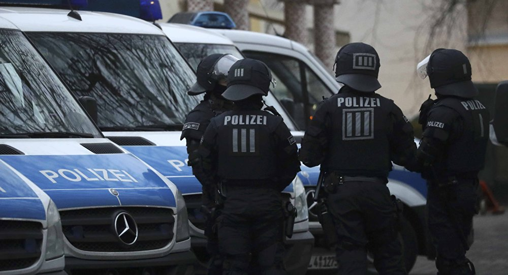 German special police forces stand guard in front of Frankfurt's Bilal mosque during early morning raids in the federal state of Hesse and its capital Frankfurt, Germany, February 1, 2017