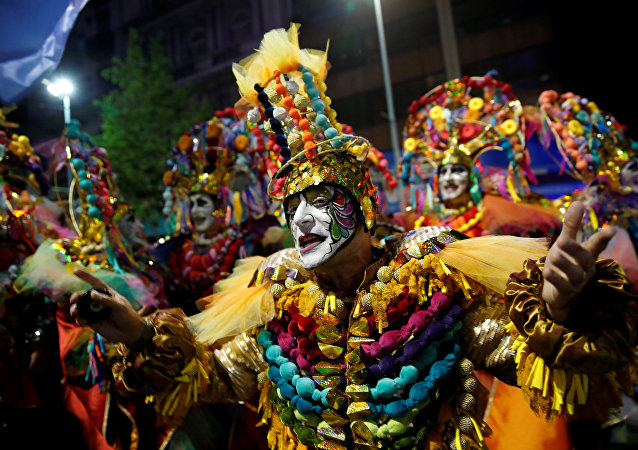 Members of an Uruguayan carnival group participate in the inaugural parade of the Uruguayan Carnival in Montevideo