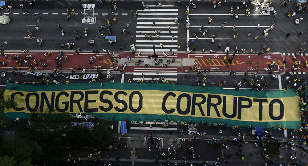 Demonstrators protest along Paulista Avenue in Sao Paulo, Brazil