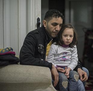 Familia de refugiados sirios