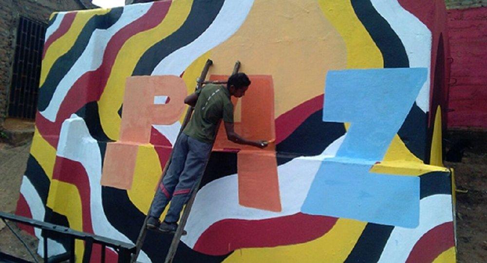 Un hombre pinta la palabra Paz, Colombia