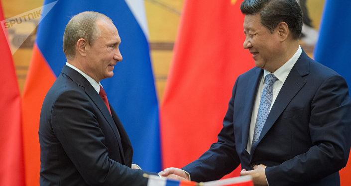 Vladímir Putin, presidente de Rusia, y Xi Jinping, presidente de China