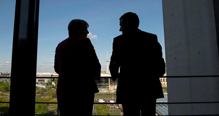 Ángela Merkel, canciller de Alemania, y Emmanuel Macron, presidente electo de Francia