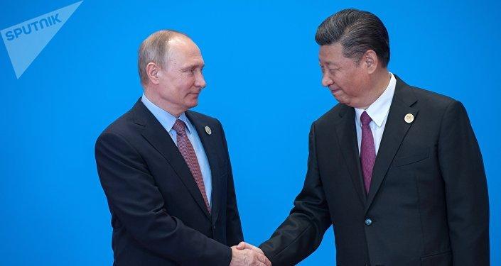 Vladímir Putin, presidente de Rusia y Xi Jinping, presidente de China